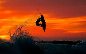 Surfer Jumping